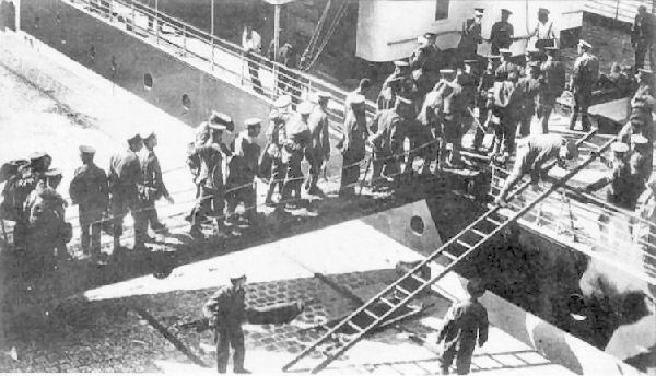 A hospital ship at Le Havre with wounded soldiers boarding